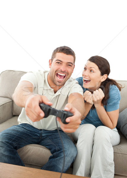 Cheerful woman encouraging her boyfriend playing video game at home Stock photo © wavebreak_media