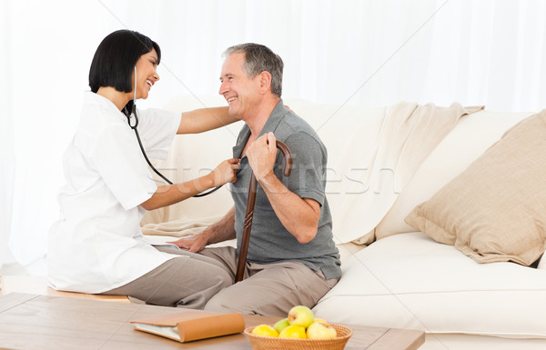 Retired man with his nurse at home Stock photo © wavebreak_media