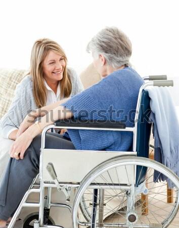 Seniors talking together in the livingroom Stock photo © wavebreak_media