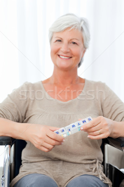 Woman looking at the camera in her wheelchair Stock photo © wavebreak_media
