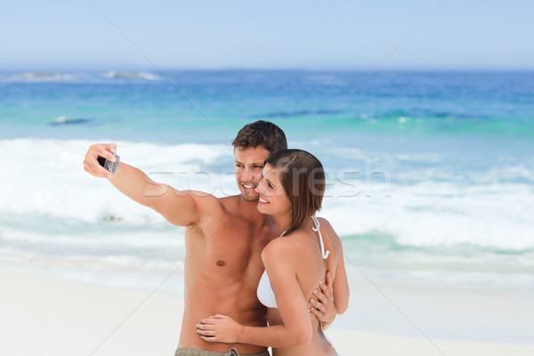 Lovers with their camera at the beach Stock photo © wavebreak_media