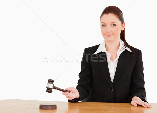 Young judge knocking a gavel smiling at the camera  against a white background Stock photo © wavebreak_media