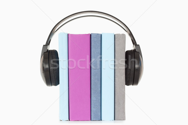 Close up of books and headphones against a white background Stock photo © wavebreak_media