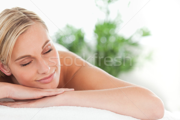 Close up of a woman lying on a lounger eyes closed in a wellness center Stock photo © wavebreak_media