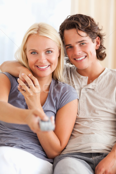 Portrait of a lovey couple watching TV in their living room Stock photo © wavebreak_media