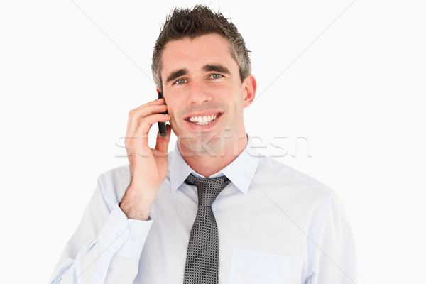Smiling man making a phone call against a white background Stock photo © wavebreak_media
