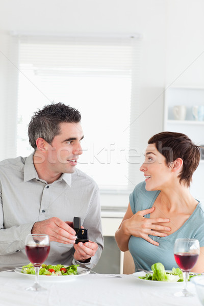 Man proposing to his cute girlfriend in a dining room Stock photo © wavebreak_media