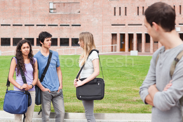 Student looking at one of his classmates talking outside a building Stock photo © wavebreak_media