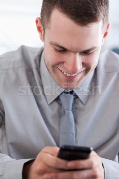 Közelkép mosolyog üzletember kellemes szöveges üzenet telefon Stock fotó © wavebreak_media