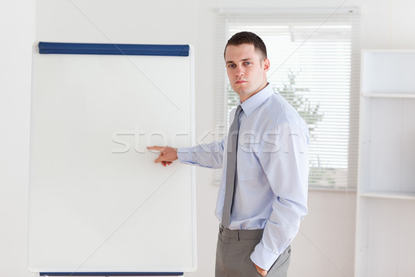 Businessman pointing at something important at flip chart Stock photo © wavebreak_media