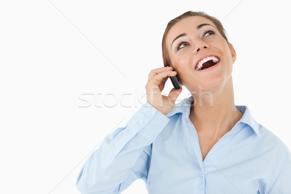 Stock photo: Laughing businesswoman on the phone against a white background