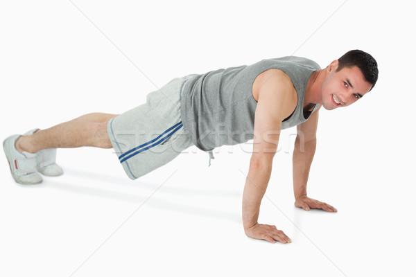 Oldalnézet férfi fekvőtámaszok fehér test háttér Stock fotó © wavebreak_media