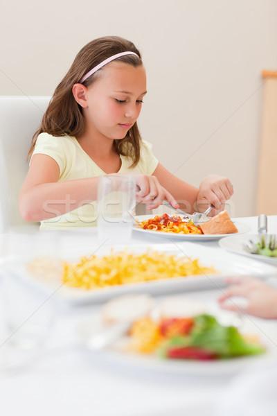 Kız yeme yemek masası salata gülen mutluluk Stok fotoğraf © wavebreak_media