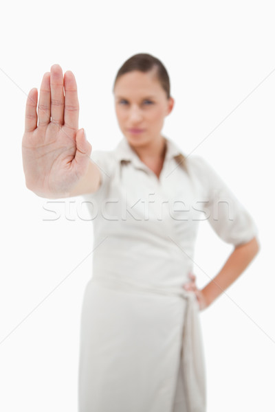 Portrait of a fit businesswoman making a stop sign with the camera on her hand Stock photo © wavebreak_media