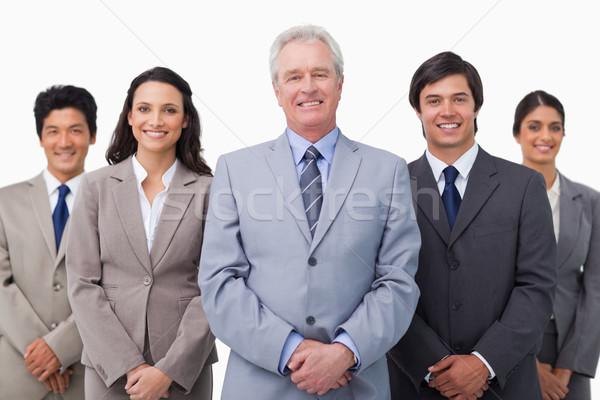 Sorridere maturo imprenditore piedi squadra bianco Foto d'archivio © wavebreak_media