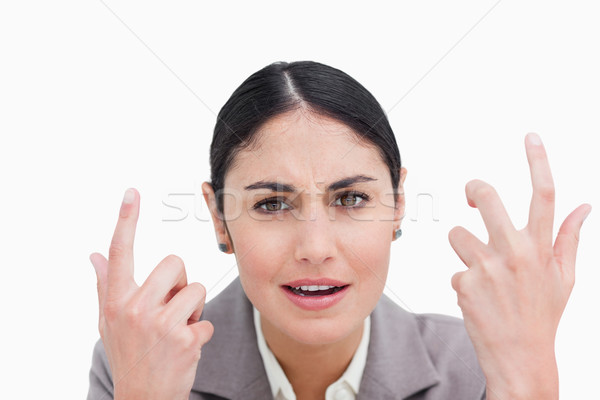 Close up of confused looking businesswoman against a white background Stock photo © wavebreak_media