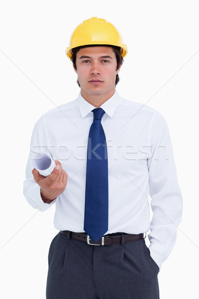 Male architect with helmet and plans against a white background Stock photo © wavebreak_media