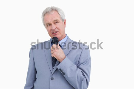 Mature tradesman using microphone against a white background Stock photo © wavebreak_media