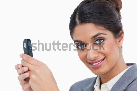 Close up of female entrepreneur with her mobile phone against a white background Stock photo © wavebreak_media