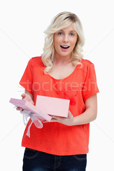 Young woman looking at the camera after opening her surprising birthday gift Stock photo © wavebreak_media
