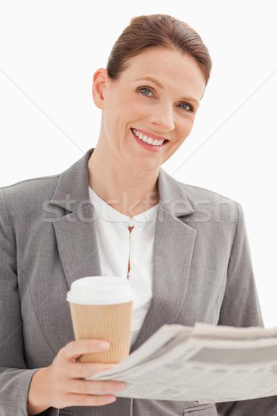 улыбаясь деловая женщина газета Кубок бизнеса Сток-фото © wavebreak_media