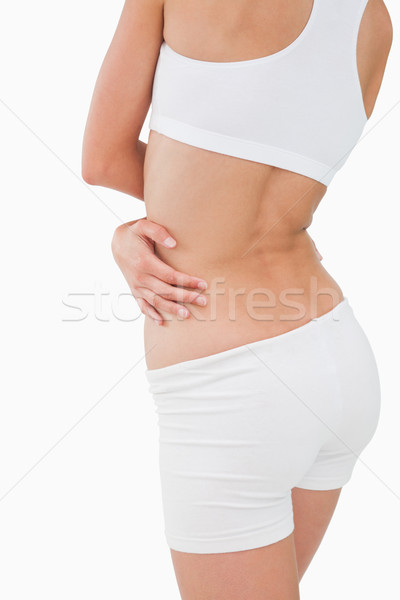 Rear view of a beautiful slim body against white background Stock photo © wavebreak_media