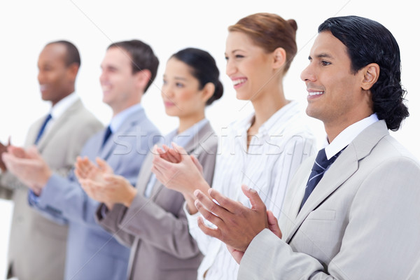 Close-up of  happy business people applauding against white background Stock photo © wavebreak_media