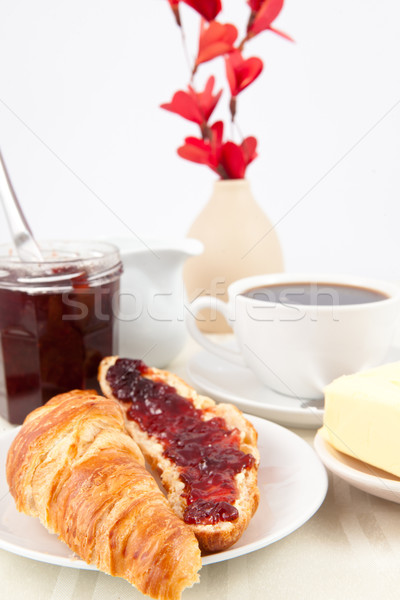 Table presentation with croissant spread with jam indoors Stock photo © wavebreak_media