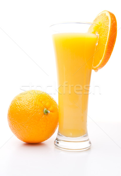 Orange near a glass of orange juice against white background Stock photo © wavebreak_media