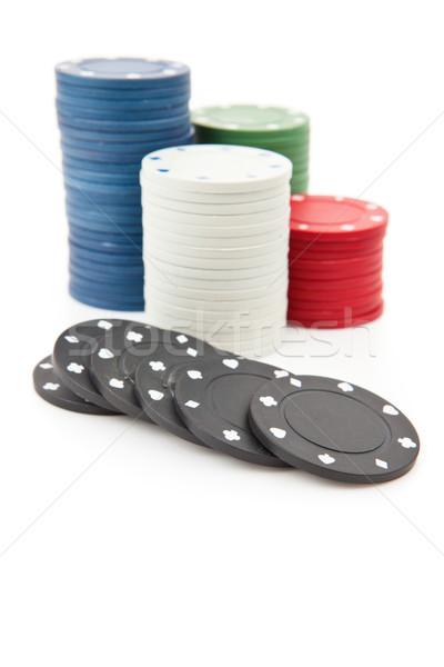 Many poker tokens piled up against a white background Stock photo © wavebreak_media