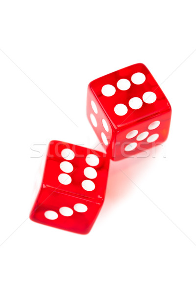 Two red dices rolling against a white background Stock photo © wavebreak_media