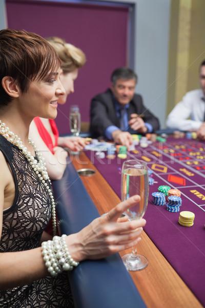 Donna vetro roulette casino soldi Foto d'archivio © wavebreak_media