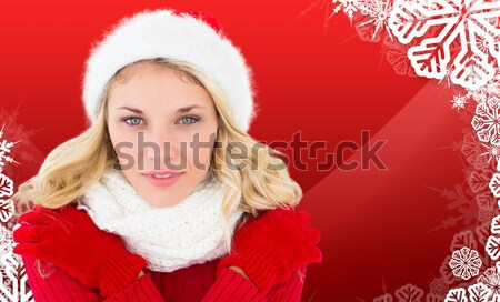Composite image of pretty girl in santa outfit blowing Stock photo © wavebreak_media