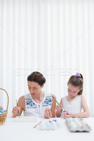 Mother and daughter painting easter eggs Stock photo © wavebreak_media