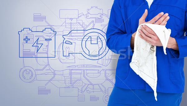 Image mécanicien main serviette gris Photo stock © wavebreak_media