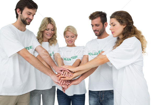 Group of young volunteers with hands together Stock photo © wavebreak_media