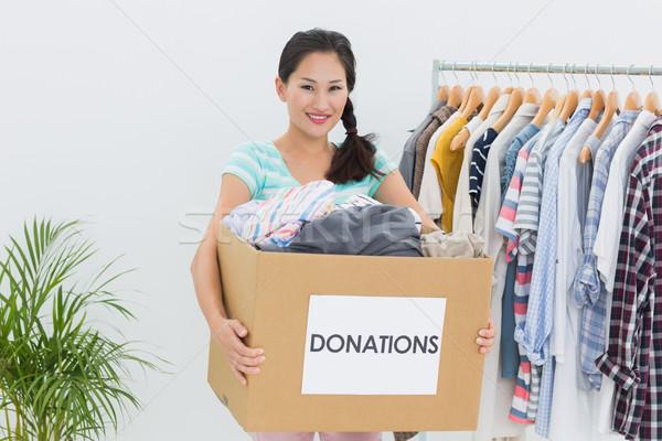 Mulher jovem roupa doação retrato escritório feliz Foto stock © wavebreak_media