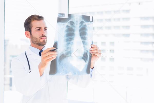 Male doctor examining xray in medical office Stock photo © wavebreak_media
