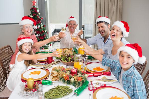 Family in santas hats toasting wine glasses at dining table Stock photo © wavebreak_media