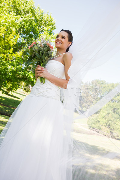 Happy young beautiful bride with bouquet in park Stock photo © wavebreak_media