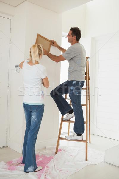 Couple decorating their new house Stock photo © wavebreak_media