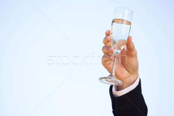 手 シャンパン ガラス 晴天 クローズアップ 空 ストックフォト © wavebreak_media