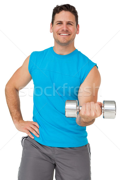 Portrait of a fit man exercising with dumbbell Stock photo © wavebreak_media