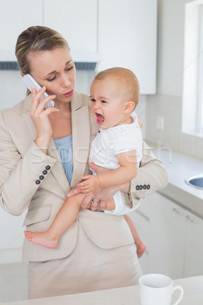 女性実業家 泣い 赤ちゃん 話し 電話 ストックフォト © wavebreak_media