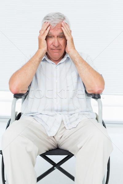 Sad senior man sitting in wheelchair Stock photo © wavebreak_media