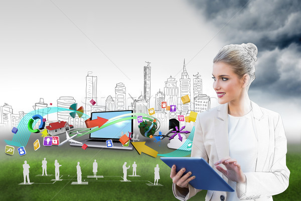 Blonde businesswoman using tablet pc with cityscape and laptop Stock photo © wavebreak_media