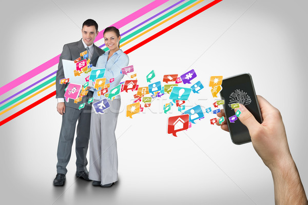 Main smartphone app icônes Photo stock © wavebreak_media