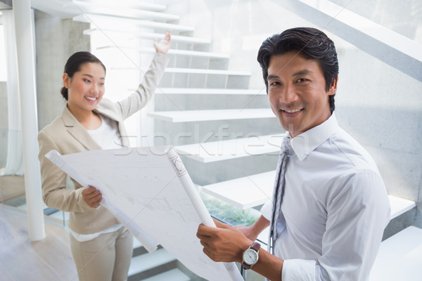 Stock photo: Estate agent showing stairs to potential buyer
