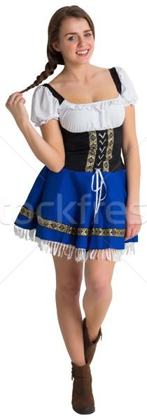 Mooie oktoberfest meisje glimlachend camera witte Stockfoto © wavebreak_media