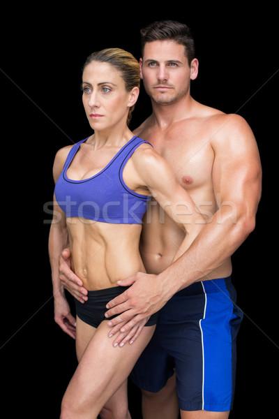 Montare bodybuilding Coppia posa insieme nero Foto d'archivio © wavebreak_media
